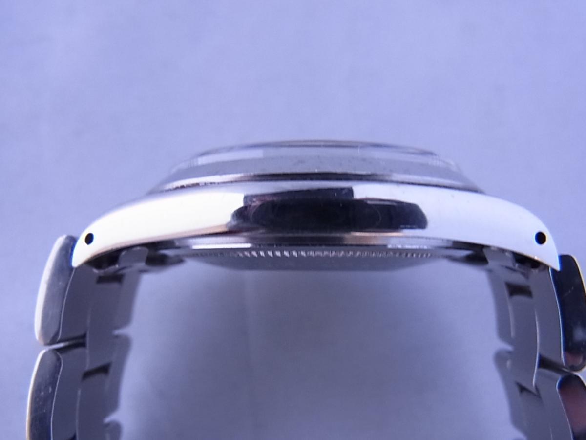 チュードルデカバラリダン 時計本体のみ 1960年代 34mmラウンド型のシルバーケースにブラックダイヤルの高額売却実績と9時ケースサイド画像